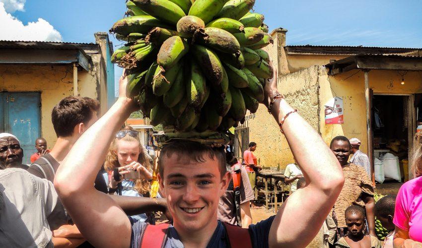 school_expedition_uganda_trek_boy_holding_bananas