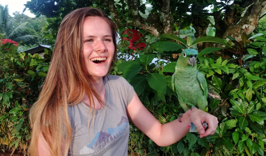 camps_international_about_us_girl_holding_parrot