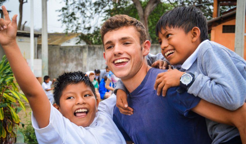 camps_international_about_us_piggyback_with_students