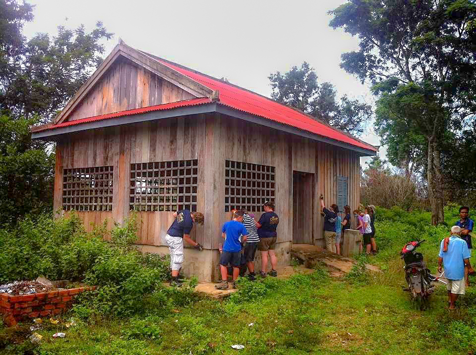 school_expedition_cambodia_trek_painting_building