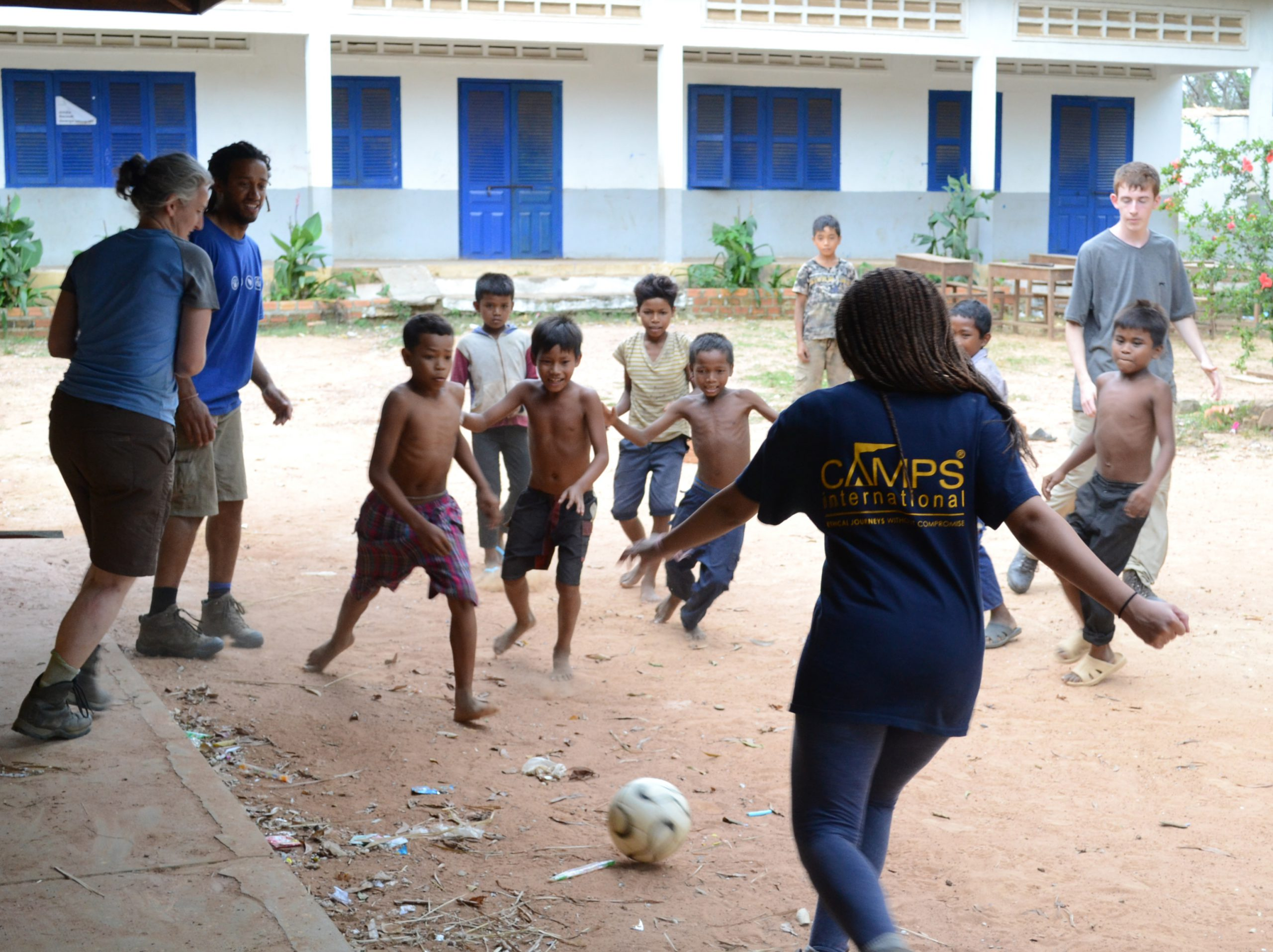 volunteer_playing_football_with_local_school_children