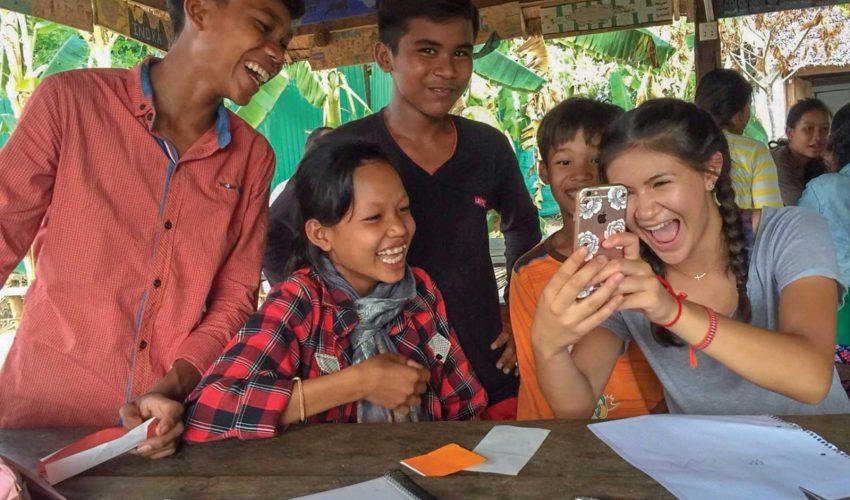 school_expedition_cambodia_impact_smiling_phone
