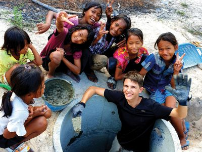 school_expedition_cambodia_impact_well_building