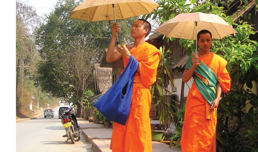 school_expeditions_laos_impact_monks_walking