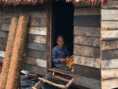 school_expedition_cambodia_rws_man_at_home