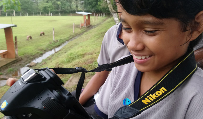 school_expedition_costa_rica_impact_girl_with_camera
